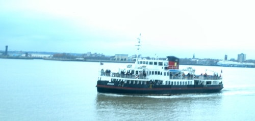 MV Snowdrop (one of the iconic Mersey Ferries) on the River Mersey with Liverpool skyline in the background