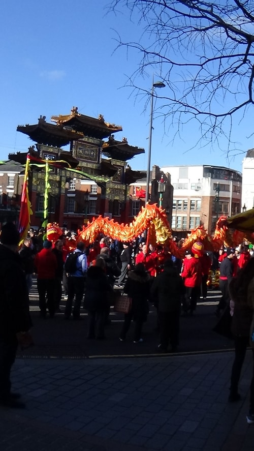 Chinese New Year Liverpool 2016 Chinese dragon with Chinese Arch in background at entrance to Chinatown 7th February 2016