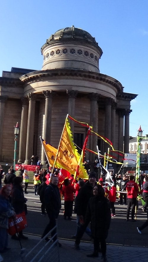 Chinese New Year Liverpool 2016 parade with flags with Chinese Arch in background at entrance to Chinatown 7th February 2016 photo 4