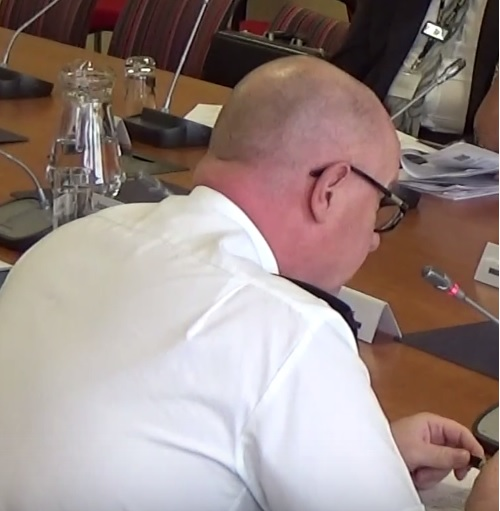 Deputy Chief Constable Andy Cooke (with his microphone on) at the Police and Fire Collaboration Committee meeting of Merseyside Fire and Rescue Authority 7th June 2016
