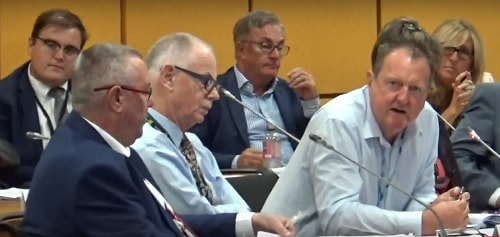 Cllr Steve Foulkes (Lead Member for Finance and Organisational Development) front (right) answering a question at a public meeting of the Transport Committee (Liverpool City Region Combined Authority) 9th August 2018