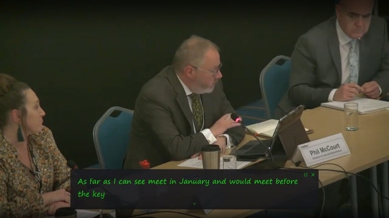 What happened at a public meeting of Wirral Council's Policy and Resources Committee to discuss budget cuts proposals for 2022/23?